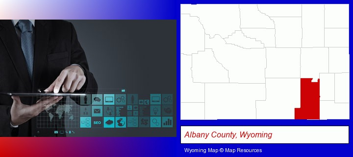 information technology concepts; Albany County, Wyoming highlighted in red on a map