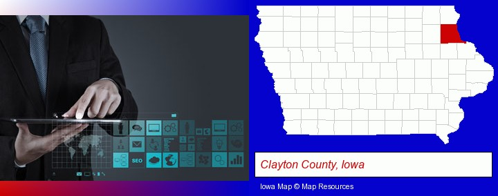 information technology concepts; Clayton County, Iowa highlighted in red on a map