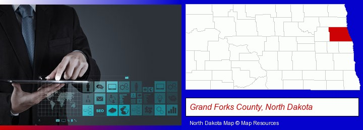 information technology concepts; Grand Forks County, North Dakota highlighted in red on a map