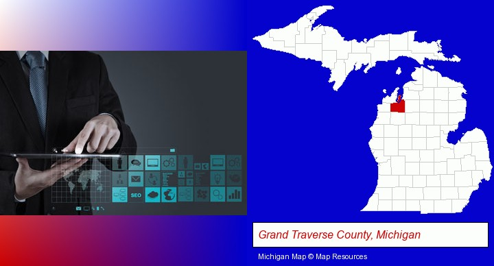 information technology concepts; Grand Traverse County, Michigan highlighted in red on a map