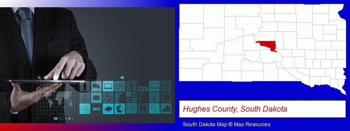 information technology concepts; Hughes County, South Dakota highlighted in red on a map