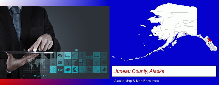 information technology concepts; Juneau County, Alaska highlighted in red on a map